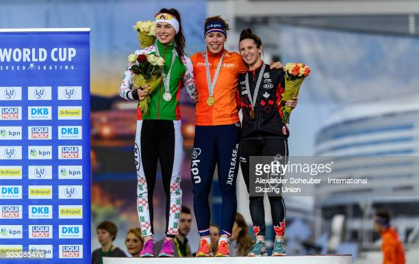 Marina Zueva of Belarus Antoinette de Jong of the Netherlands and Ivanie Blondin of Canada stand on the podium after the Ladies 3000m Final during...