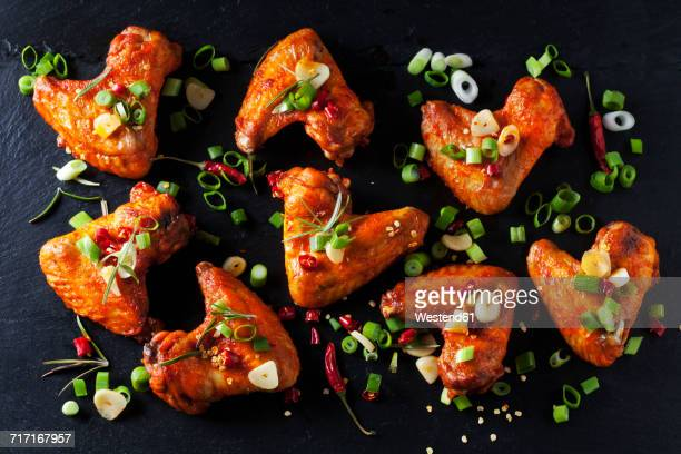 Marinated and grilled chicken wings on slate