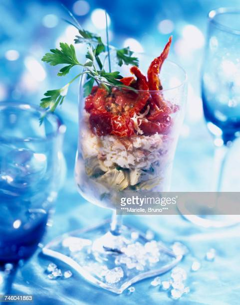 Marinated artichoke with crab and dried tomatoes