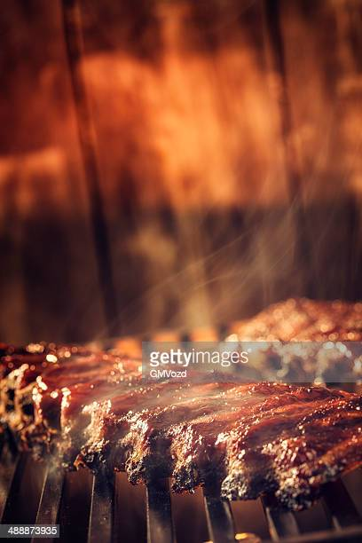 marinated bbq pork ribs on barbecue grill - sparerib stock photos and pictures