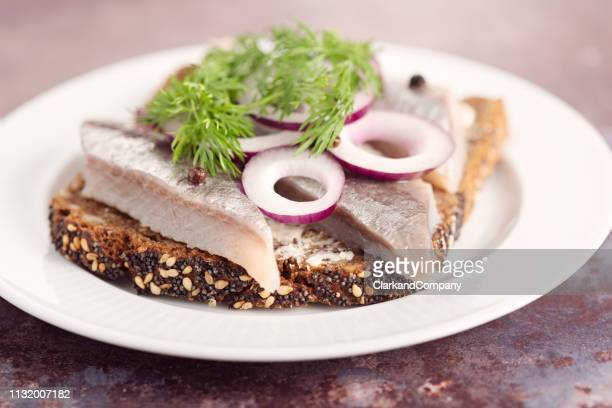 marinated herring with onion and dill. - danish culture stock pictures, royalty-free photos & images