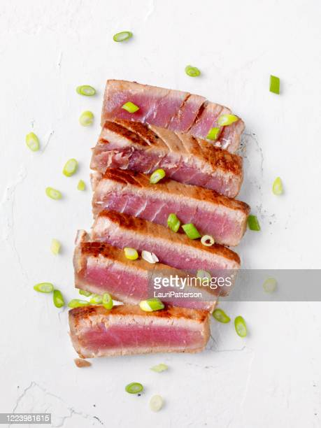marinated seared tuna steak - high key stock pictures, royalty-free photos & images