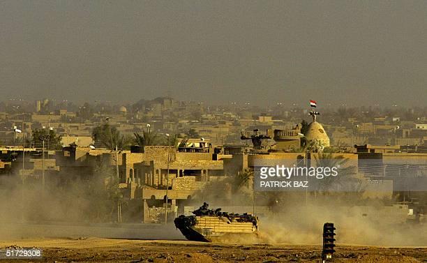 US marine AAV patrols the Jolan neighborhood of the restive Sunni Muslim city of Fallujah 11 November 2004 west of Baghdad The US military estimates...