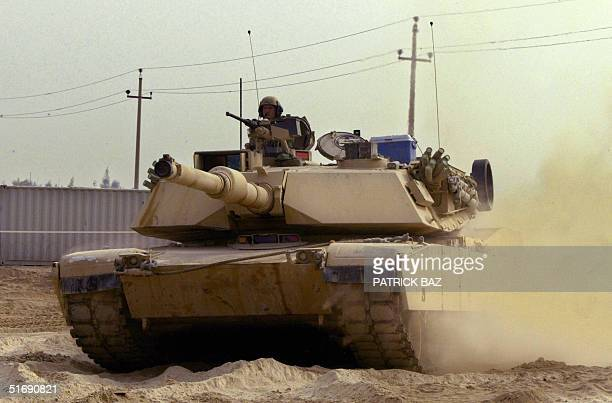 US marine Abrams tank maneuvers in Camp Fallujah west of Baghdad 06 November 2004 near the Muslim Sunni city of Fallujah Iraqi security forces are...