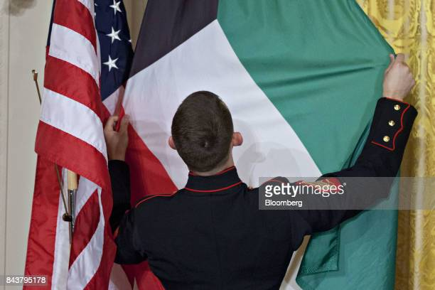 A US Marine adjusts the Kuwaiti flag ahead of a news conference with US President Donald Trump and Sheikh Sabah AlAhmed AlSabah Kuwait's emir not...