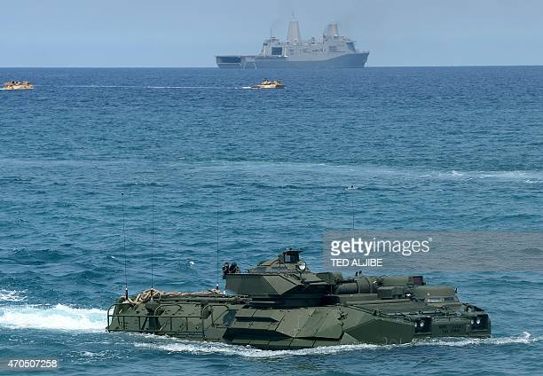 Marine amphibious assault vehicle makes its way to shore after leaving an amphibious transport dock ship during a landing exercise on a beach at San...