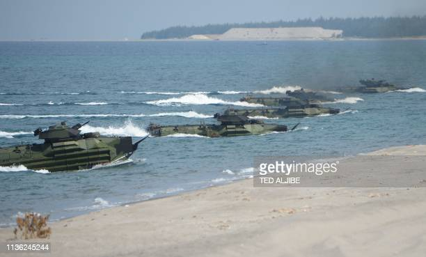 US Marine Amphibious Assault Vehicles prepare to hit the beach during the amphibious landing exercises as part of the annual joint USPhilippines...