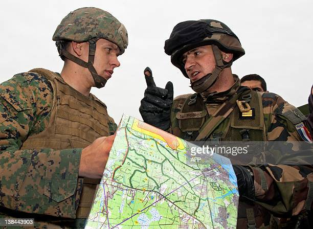 Marine and a member of the French Army talk about the map January 6 after a beach head landing during Operation Bold Alligator 2012 a multinational...
