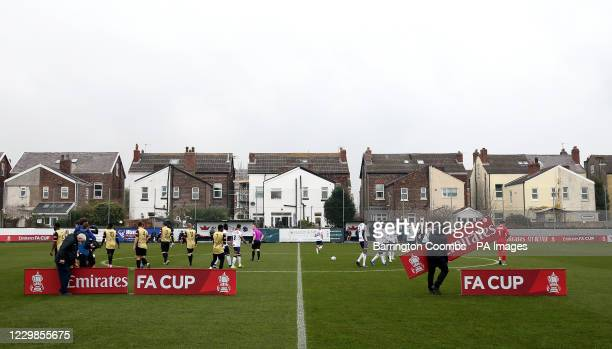 Marine and Havant And Waterlooville head out to the pitch to line up before the Emirates FA Cup second round match at Rossett Park, Crosby.
