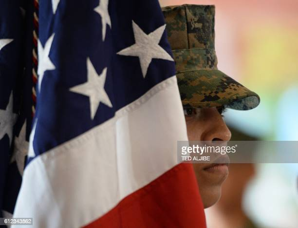 A US marine and member of the color guard stands next to the US national flag during the opening ceremony of the Amphibious Landing Exercise at the...