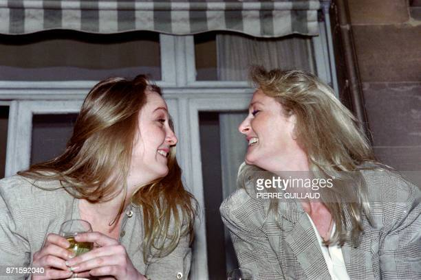 Marine and Yann Le Pen daughters of JeanMarie Le Pen France's farright and presidential candidate share a laugh on April 24 1988 at the balcony of...