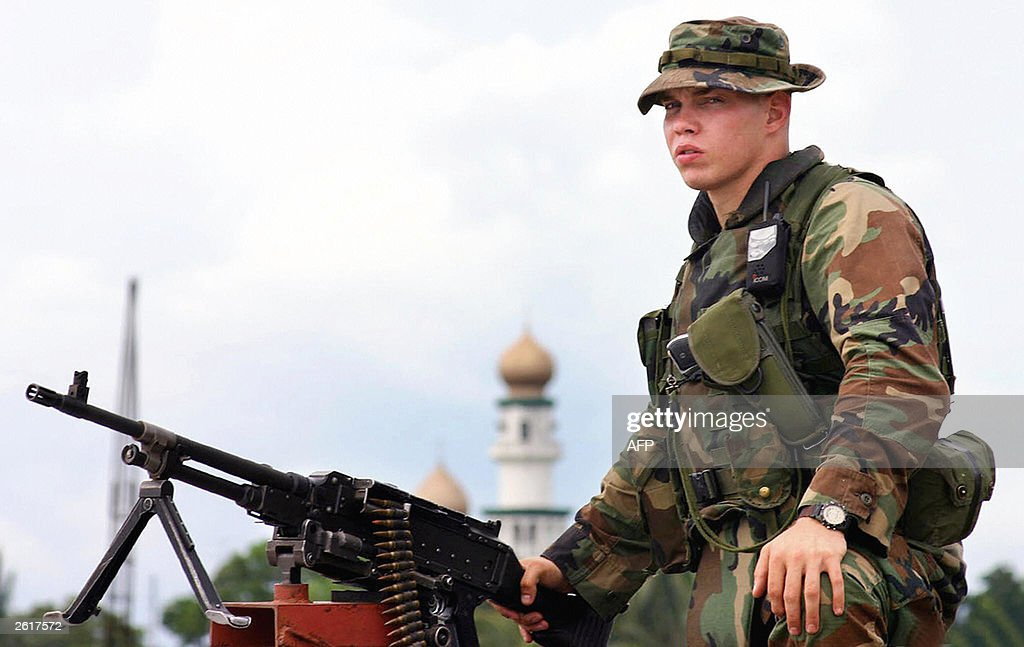 marine armed with a machine gun guards a school site near the taluksangay mosque in
