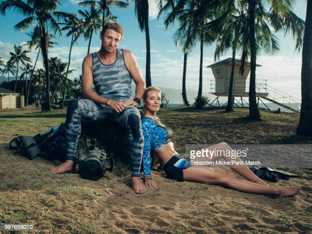 Marine biologist and conservationist Ocean Ramsey and underwater photographer Juan Oliphant are photographed for Paris Match on the Hawaiian beach of...