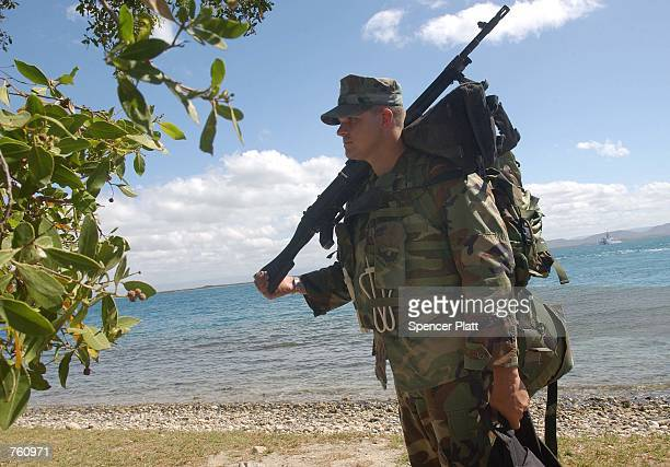 S Marine Bruce Heckerdorn of Dickinson Texas is deployed April 18 2002 to another position on Guantanamo Bay Cuba Nearly 300 detainees which are...