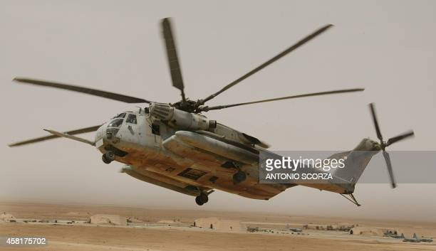 Marine C853 helicopter takes off 26 May 2004 from the alAsad base in the west of Iraq for a mission US and British troops in Iraq will stay under US...
