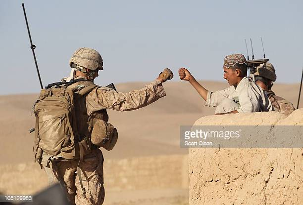 S Marine Capt Tom Kearns of Bordentown NJ attached to India Battery 3rd Battalion 12th Marine Regiment gets a fist bump while patrolling through a...