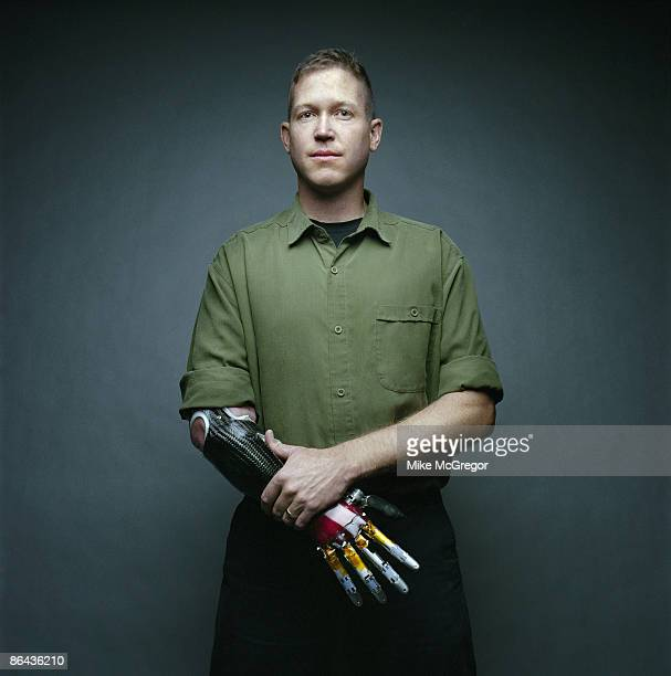 Marine Captain and Iraqi Vet Jonathan Kuniholm poses at a portrait session for IEEE Spectrum Magazine wearing a prototype of a neurally controlled...