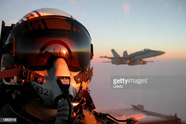 S Marine Captain Christopher Niemann of the VMFA323 'Death Rattlers' squadron flies his F/A18 Hornet over Kuwait March 27 2003 as he returns to the...