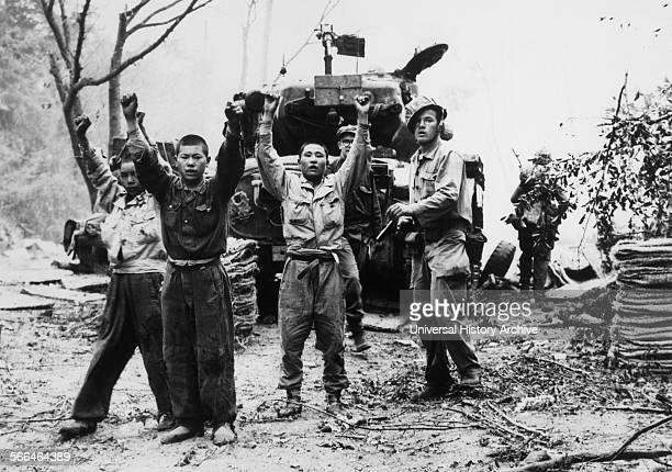 Marine capturing north Korean prisoners of war. Korean War 1953.