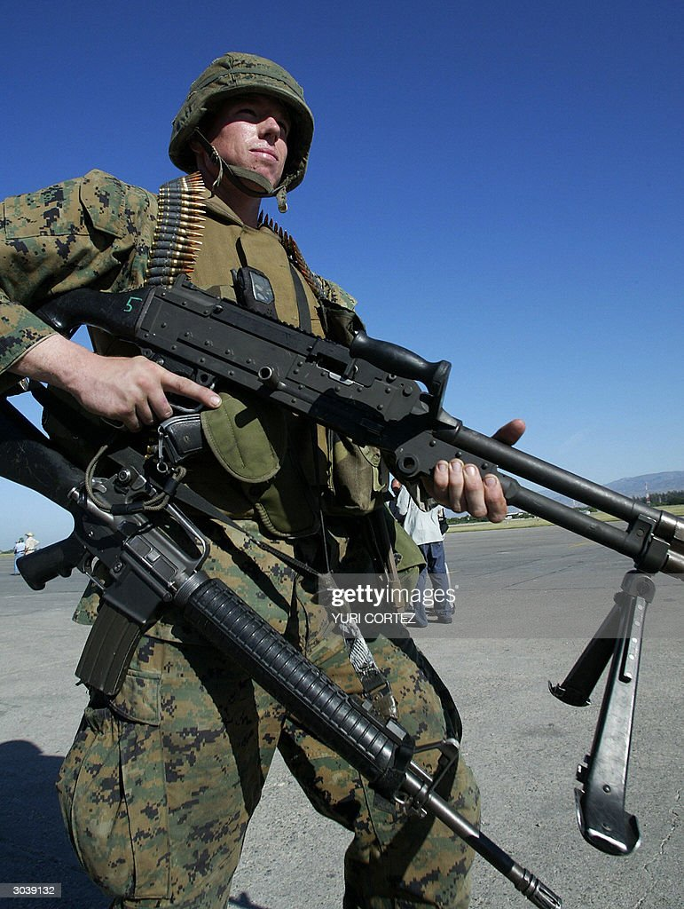 A US Marine carries a high caliber machi : News Photo