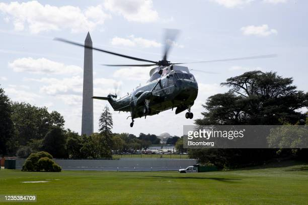 Marine, carrying U.S. President Joe Biden, arrives on the South Lawn of the White House in Washington, D.C., U.S., on Monday, Sept. 20, 2021. The...