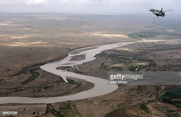 Marine CH-53 transport helicopter flies over a branch of the Helmand River and opium poppy fields April 6, 2009 in Helmand province, Afghanistan. The...