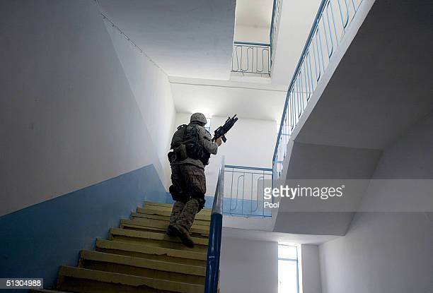 S Marine climbs the stairs of a newly refurbished school while patrolling on September 14 2004 in the Iraqi Holy city of Najaf Weeks of battles...