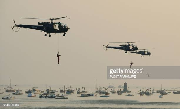Marine Commandos of the Indian Navy take part in a simulated hostage rescue operation at The Gateway of India during a rehearsal for forthcoming Navy...