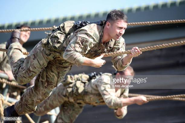 Marine Commandos on the assault course as Prince Harry Duke of Sussex visits The Royal Marines Commando Training Centre on September 13 2018 in...
