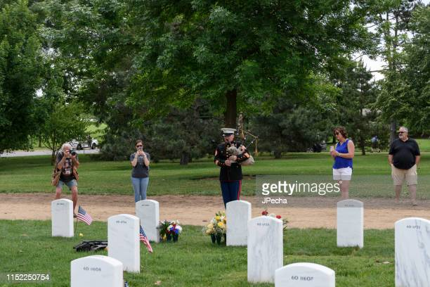 marine corp bagpipe tribute playing taps - hero corp stock pictures, royalty-free photos & images
