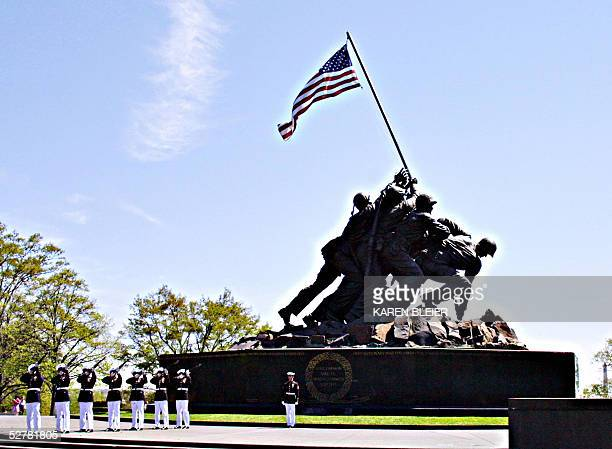 Marine Corp firing party practices in front of the Iwo Jima Memorial 26 April 2005 in Arlington VA The memorial depicting the infamous flag raising...