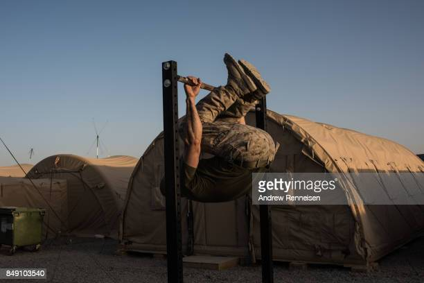 S Marine Corp Major Ethan Krumnow from Wisconsin works out at the gym at Camp Shorab on September 11 2017 in Helmand Province Afghanistan About 300...