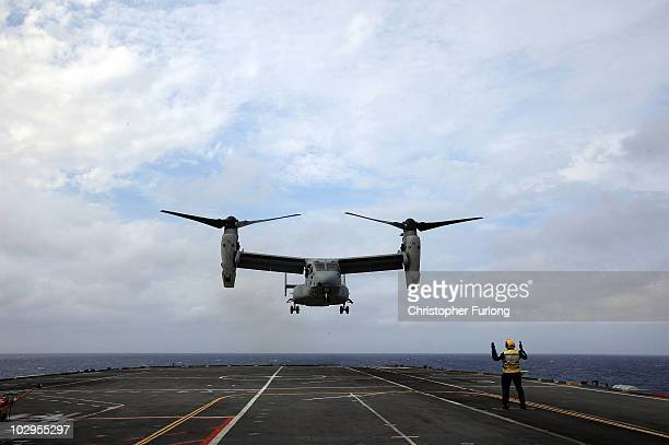 Marine Corp V22 Osprey lands on board HMS Ark Royal for the first time during Exercise Auriga on July 14 2010 at sea in Onslow Bay near North...