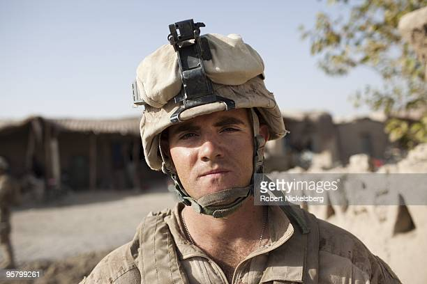 Marine Corporal Charles Dampier 28 years from Gainesville Florida patrols the partially deserted market August 13 2009 in Khan Neshin Afghanistan Cpl...