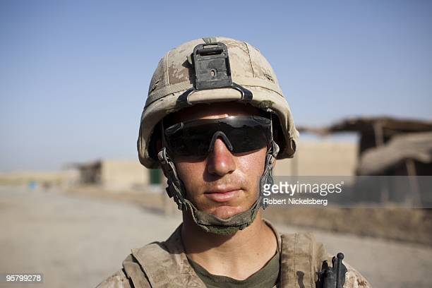 Marine Corporal Chris Seyfried 22 years from Lehighton PA patrols the partially deserted market August 13 2009 in Khan Neshin Afghanistan Cpl...
