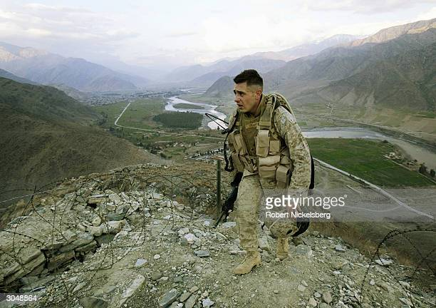 A US Marine Corporal Gravenese from Harrison New York patrols in Asadabad Afghanistan 10 kms from the Pakistani border January 31 2004 Asadabad in...