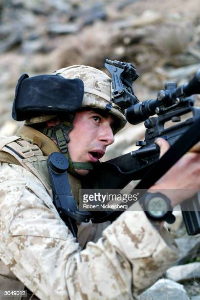 Marine, Corporal Gravenese from Harrison, New York, patrols in Asadabad, Afghanistan, 10 kms from the Pakistani border, January 31, 2004. Asadabad,...