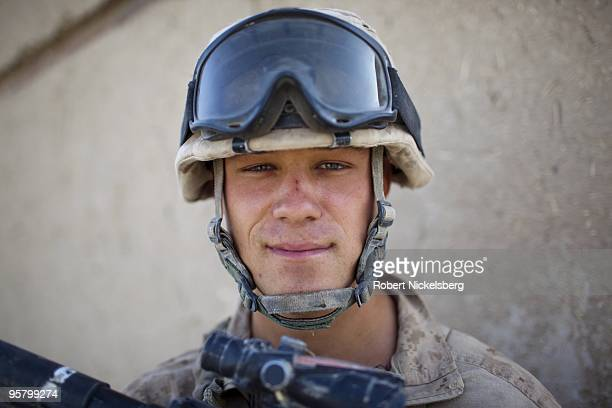 Marine Corporal Ian Beaule 23 years from Lewiston Maine patrols the partially deserted market August 13 2009 in Khan Neshin Afghanistan Cpl Beuale is...