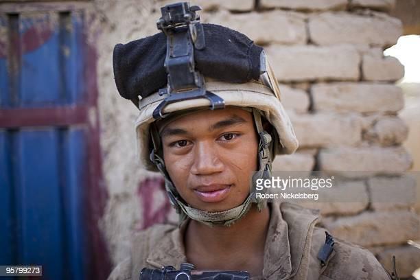 Marine Corporal Somuel Ksor 21 years from Greensboro North Carolina patrols the partially deserted market August 13 2009 in Khan Neshin Afghanistan...