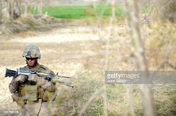 US Marine Corporal Tom Love of the 2nd Battallion 1st Marines Fox Company walks during a joint patrol with Afghanistan National Army soldiers in...