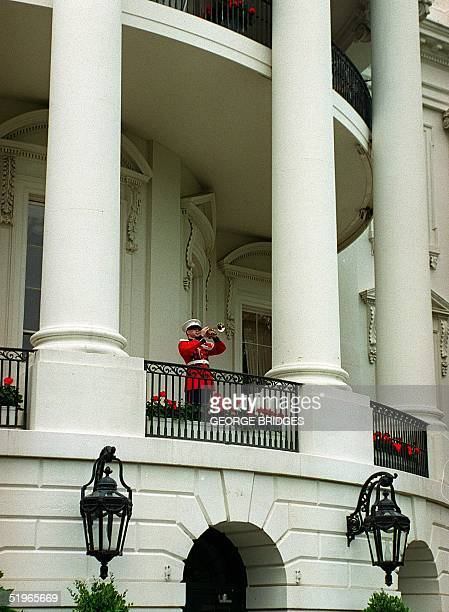 Marine Corps Band bugler plays taps from a White House balcony in observance of Memorial Day 29 May 2000 n Washington DC A moment of silence for...
