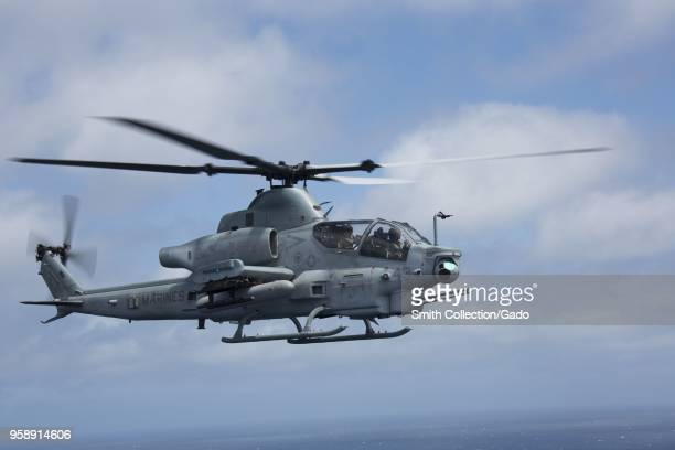 US Marine Corps Capt Alexander Hammac and 1st Lt Justin Lenhart piloting an AH64 Apache helicopter San Clemente Island California April 29 2018 Image...