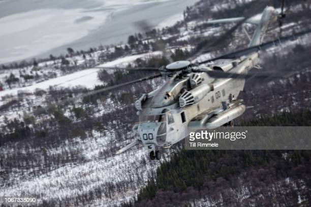 Marine Corps CH-53E Super Stallion helicopter on the lookout during an air mobile operation during cold-weather training in support of Exercise...