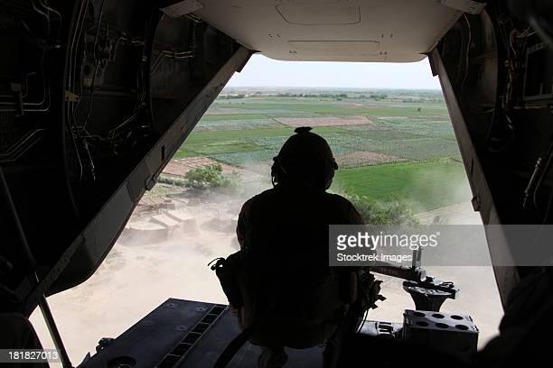 A U.S. Marine Corps. door gunner aboard an MV-22 Osprey.