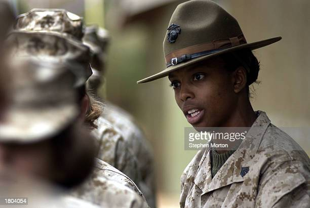 S Marine Corps Drill Instructor Sgt Subrina Dickerson instructs a female recruit February 19 2003 at Marine Corps Recruit Depot in Parris Island...
