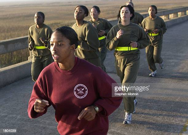 Marine Corps Drill Instructor Sgt. Subrina Dickerson leads a small pack of female recruits during run a three mile run during a physcial training...