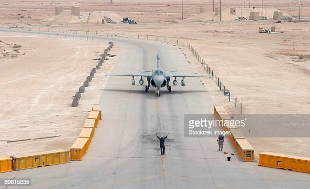 a us marine corps ea-6b prowler taxis to the hangar from the flight line at al asad air base, iraq during operation iraqi freedom. - al asad air base stock pictures, royalty-free photos & images