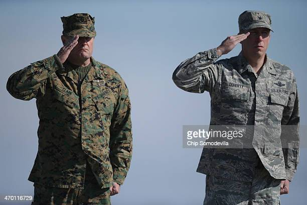 S Marine Corps Forces Special Operations Commanding General Mark Clark and US Air Force Services Director Gen Patrick Doherty salute during the...
