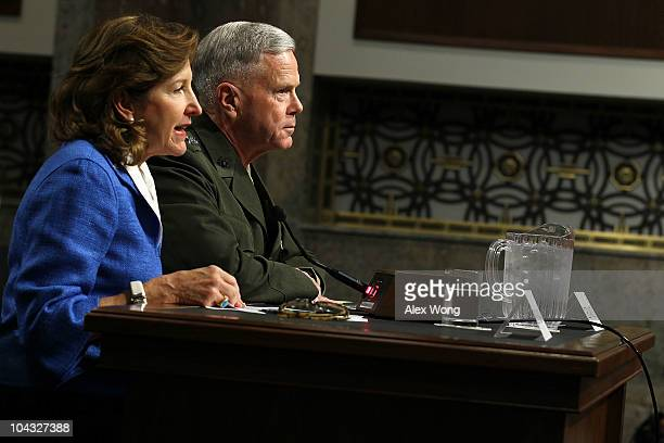 S Marine Corps Gen James Amos listens as Sen Kay Hagan introduces him during his confirmation hearing before the Senate Armed Services Committee...