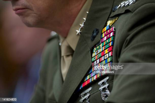 Marine Corps Gen. John Allen, commander of the International Security Assistance Force, testifies before a House Armed Services committee hearing on...